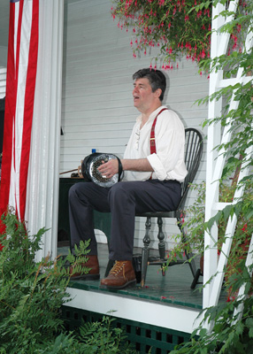 Jeff and concertina on Goodwin Mansion porch, July 4th 2006
